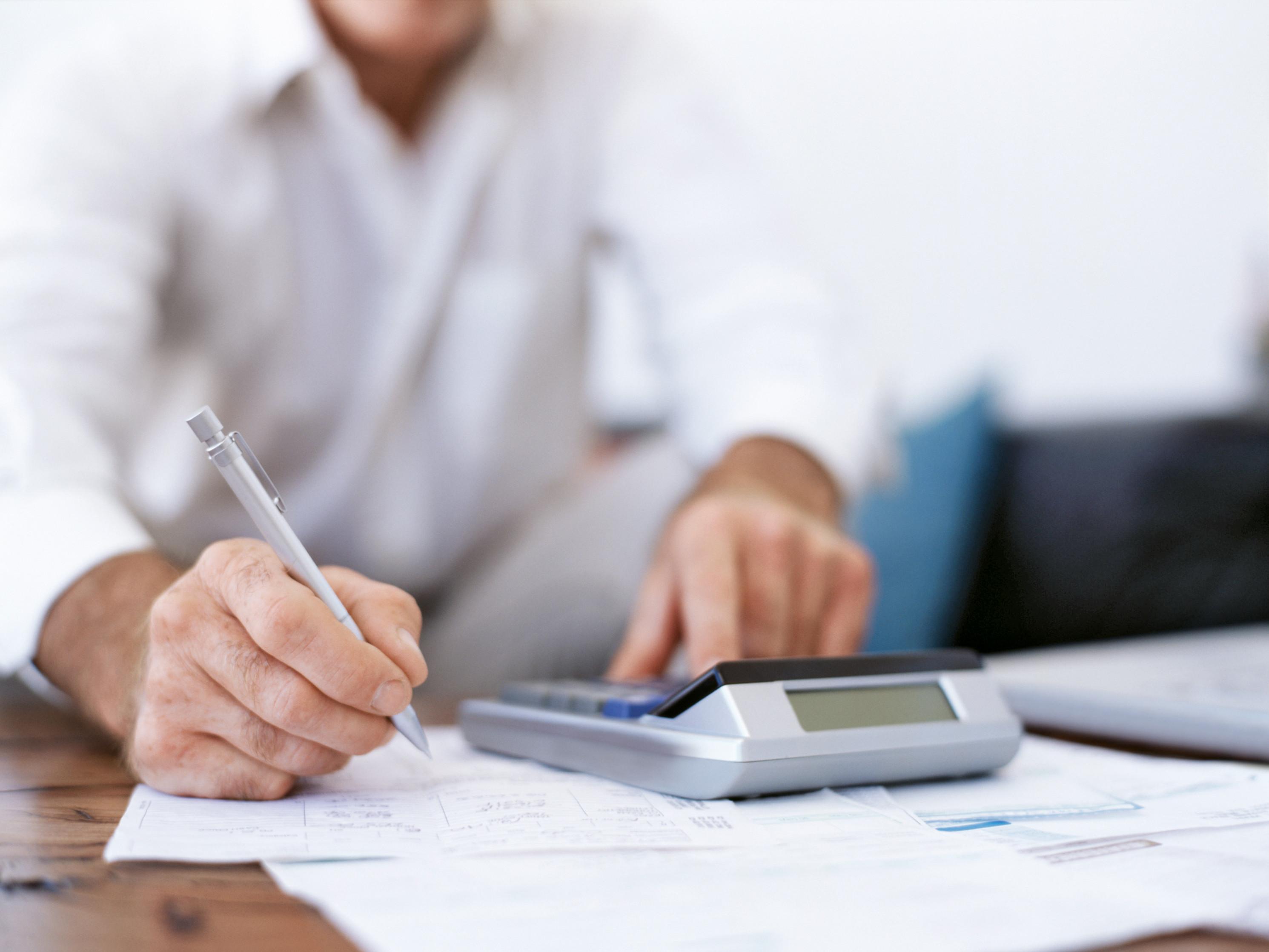 Man calculates with calculator